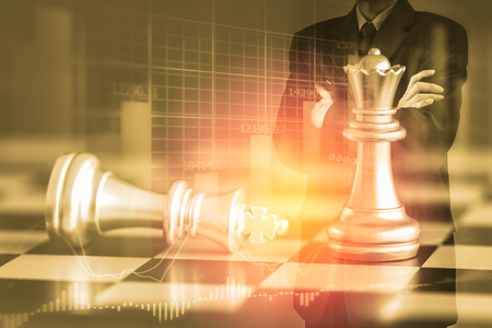 digital asset management: Business man on digital stock market financial and chess background. Digital business and stock market financial on LED. Double exposure chess business strategy and digital stock market financial.