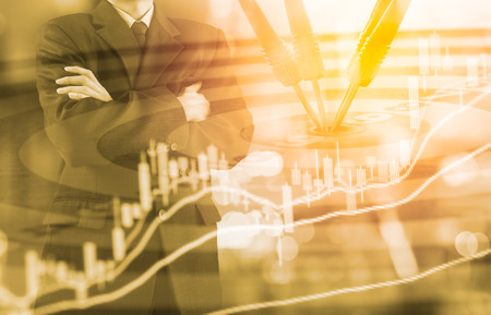 Business man on digital stock market financial and dart background. Digital business and stock market financial on LED. Double exposure target business strategy and digital stock market financial.