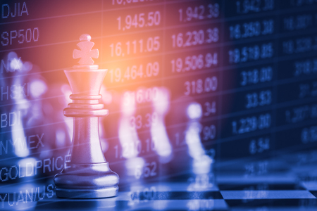 Business game on digital stock market financial and chess background. Digital business and stock market financial on LED. Double exposure chess business strategy and digital stock market financial. Stock Photo