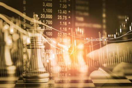 Business game on digital stock market financial and chess background. Digital business and stock market financial on LED. Double exposure chess business strategy and digital stock market financial. Banque d'images