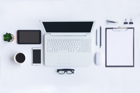 White desk office with laptop, smartphone and other work supplies with cup of coffee. Top view with copy space for input the text. Designer workspace on desk table essential elements on flat lay. 免版税图像