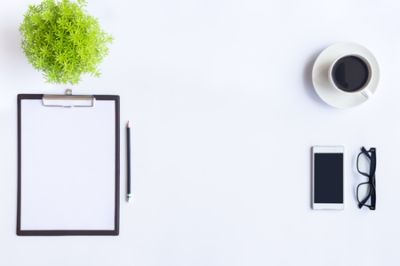 White desk office with laptop, smartphone and other work supplies with cup of coffee. Top view with copy space for input the text. Designer workspace on desk table essential elements on flat lay. Standard-Bild