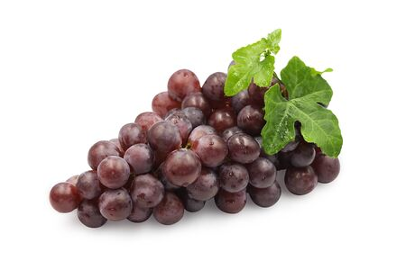 Large bunch fresh ripe organic red grape with leaves on white isolated background. Red grape have sweet taste, juicy and delicious, use for make wine. Fresh fruit concept. Foto de archivo