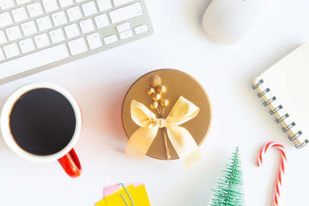 White Christmas, desk office with laptop, decoration and work supplies with cup of coffee. Top view with copy space for input the text. Flat lay desk table winter Christmas. Business Holidays Concept. Imagens