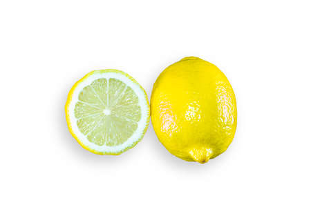 Whole and slice organic lemon on white isolated background. Fresh lemon have high vitamin C and delicious sour taste for lemonade or cooking. Citrus or citron fruit concept.