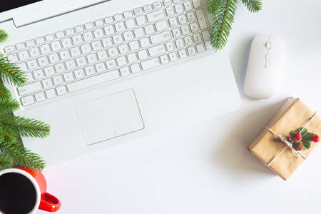 White Christmas, desk office with laptop, decoration and work supplies with cup of coffee. Top view with copy space for input the text. Flat lay desk table winter Christmas. Business Holidays Concept. Stock fotó