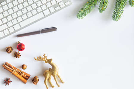 White Christmas, desk office with laptop, decoration and work supplies with cup of coffee. Top view with copy space for input the text. Flat lay desk table winter Christmas. Business Holidays Concept. Banco de Imagens