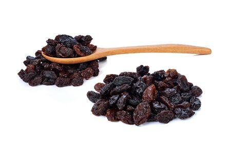 Raisins secs sur fond blanc Banque d'images