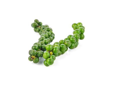 Green peppercorns on white Standard-Bild - 163359741
