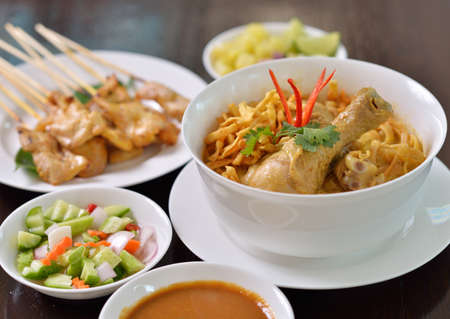 Khao Soi chicken noodle dish with other delicious dishes Standard-Bild - 163359744