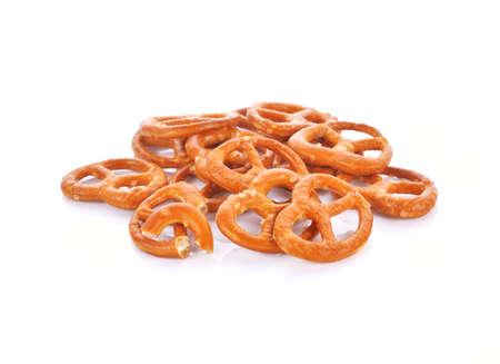 Salted pretzels on white Standard-Bild - 163360182