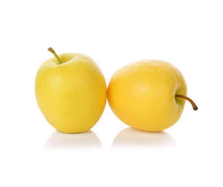 Ripe yellow apple isolated on white