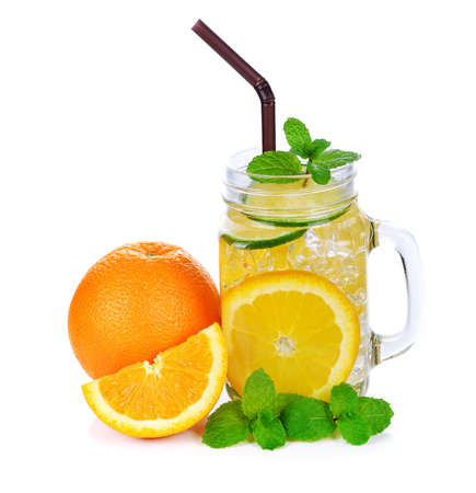 Fresh orange juice and orange on white background 免版税图像