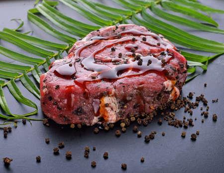 beef isolated on wood background