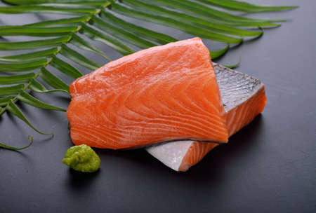 Fresh raw salmon on wood.
