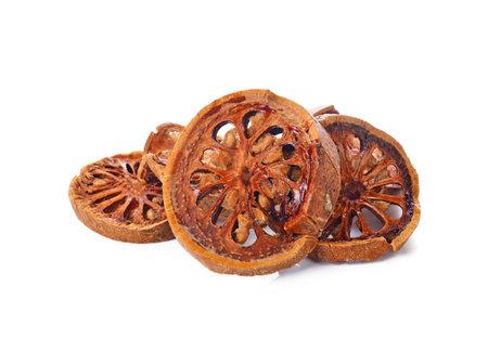 Aegle marmelos. Dry bael fruit on white background Standard-Bild