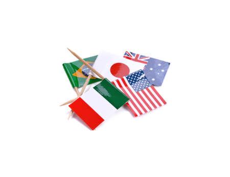 Mini paper flag. Isolated toothpick flag pointer on white background. Standard-Bild