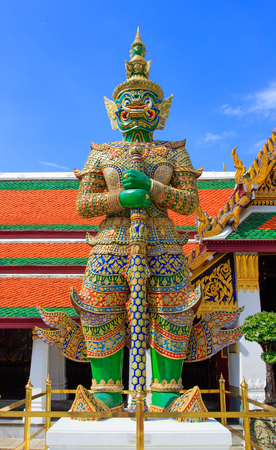 A Green giant stands upright in Wat Phra Kaew Temple Bangkok Thailand photo