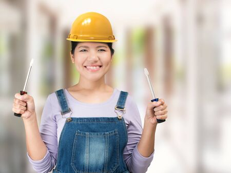 jumpsuit: asian engineering woman wearing safety helmet and jumpsuit Stock Photo