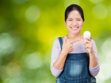 asian woman holding light bulbs