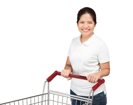 shopping cart isolated: asian woman holding shopping cart isolated on white