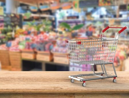 3d rendering shopping cart with supermarket background