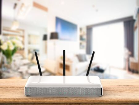 3d rendering wireless router on wooden table Stock Photo