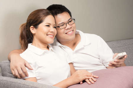 couple watching tv: asian couple watching tv at home