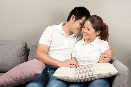 couple on couch: asian couple relaxing on couch