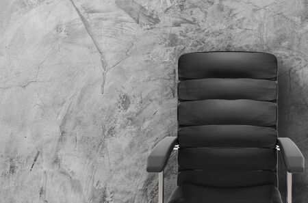 3d rendering black leather office chair with cement background