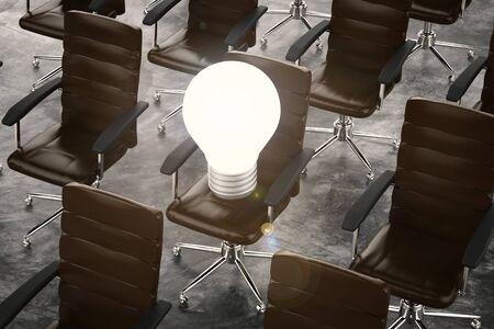 3d rendering light bulb on office chair Imagens