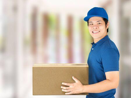 carton box: asian delivery man holding carton box