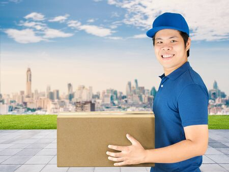 deliverer: asian delivery man holding carton box