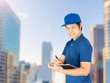 warehouseman: asian delivery man writing on notepad