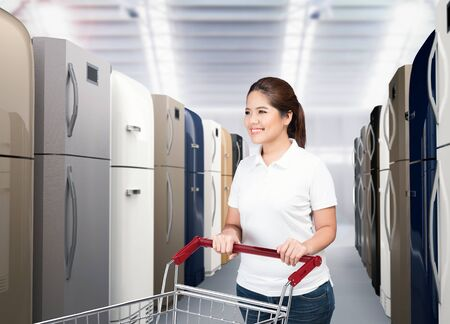 asian woman shopping refrigerator in shopping store Stock Photo