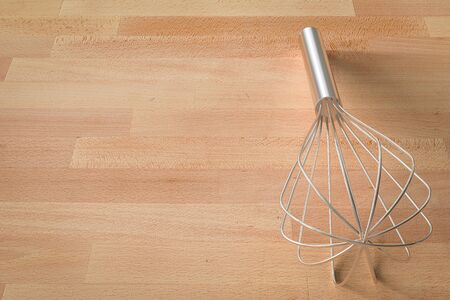 wire whisk: 3d rendering wire whisk on wooden background
