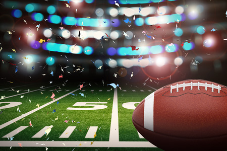 shining light: 3d rendering american football ball with shining light and confetti background