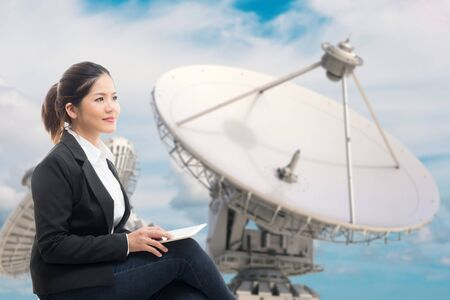 satellite dish: businesswoman with 3d rendering satellite dish background