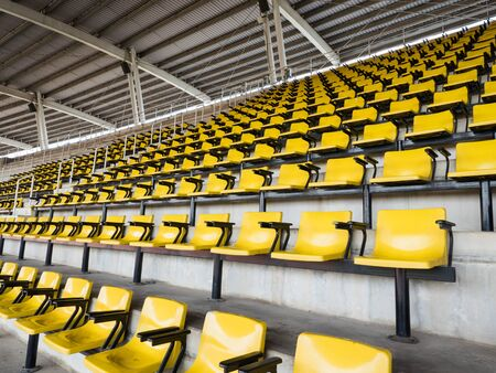 empty yellow seats in stadium