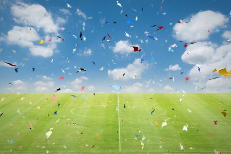 green soccer field with blowing confetti background