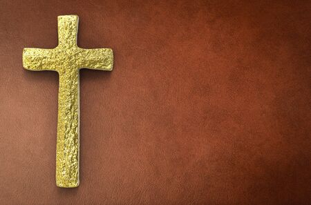 gold cross: gold cross with blank space on brown leather background