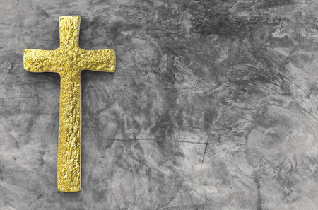 gold cross: gold cross with blank space on cement background