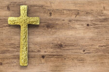 gold cross: gold cross with blank space on wooden background