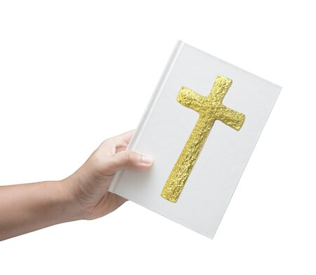 memorial cross: hand holding bible book on white background