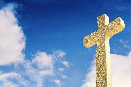 gold cross on blue sky background