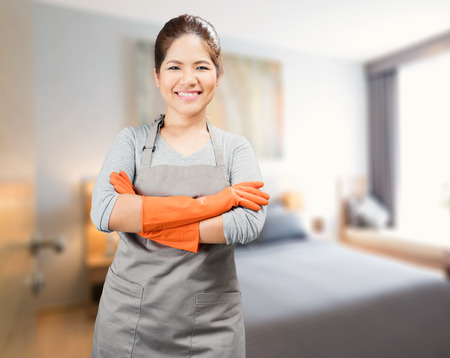 rubber gloves: asian housewife wearing rubber gloves crossed arms