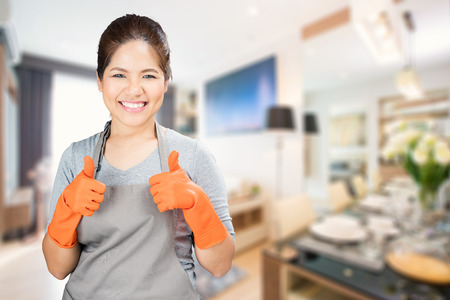 rubber gloves: asian housewife wearing rubber gloves thumbs up