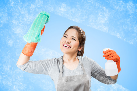 asian housewife cleaning glass Stock Photo