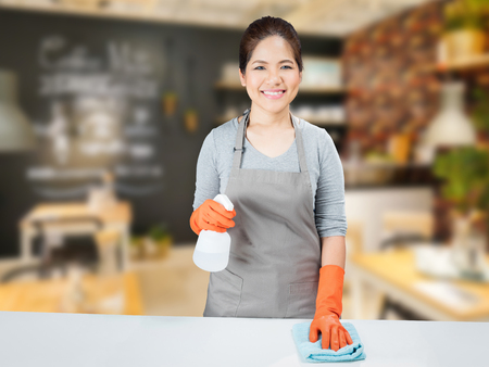 sweeper: asian housewife sweeping on table