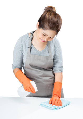 sweeper: asian housewife sweeping on table isolated on white Stock Photo